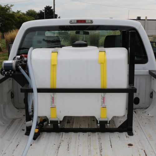 100 US Gallon Electric De-Icing Sprayer shown in the back of a pickup truck.